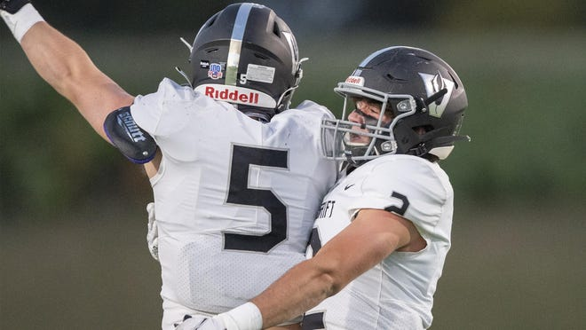 Vandegrift linebacker Austin Skoglund, left, and Logan Arnold celebrate after a sack against Vista Ridge in a District 25-6A contest earlier this month. Vandegrift's defense is allowing just 10 points a game this seaon.