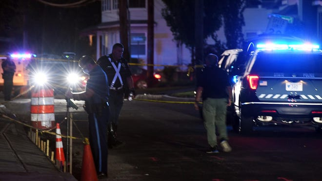 Police investigate the scene of a hit-and-run accident Aug. 18 on Washington Avenue in Natick.
