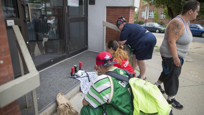 Family of David A. Smith mourn his death at a makeshift memorial at where he was fatally stabbed on North Main Street in downtown Brockton on July 19, 2014. A second man, Adrian Gonsalves,  pleaded guilty to Smith's murder on Wednesday, Oct. 28, 2020, and was sentenced to eight to 12 years in state prison.