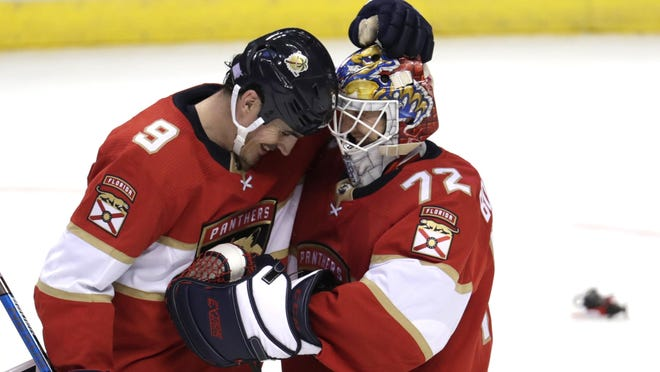 Florida Panthers center Brian Boyle (9) and goaltender Sergei Bobrovsky (72) embrace after the team's NHL hockey game against the Detroit Red Wings, Saturday, Nov. 2, 2019, in Sunrise, Fla. The Panthers won 4-0.