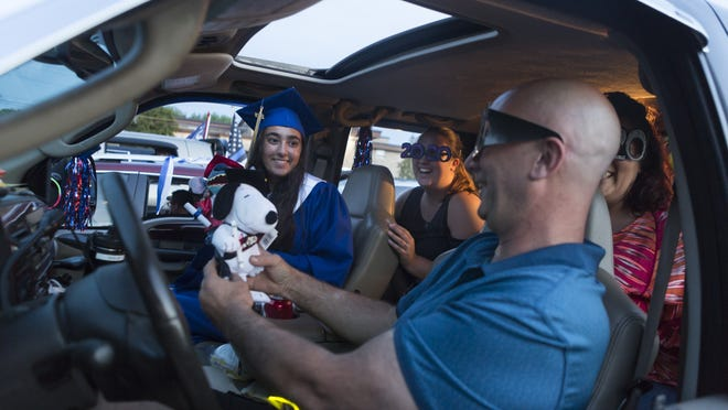 Shelby Bernardini celebrates with family inside a car at the Norfolk County Agricultural High School graduation on Thursday, June 4, 2020.