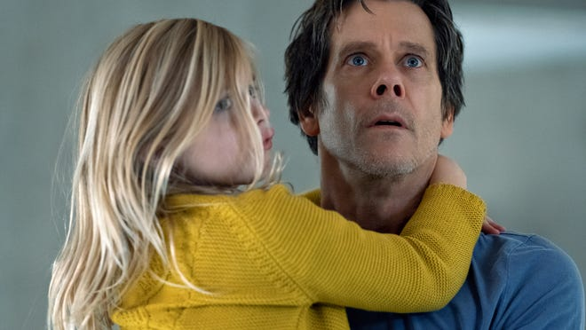 "In this image released by Universal Pictures, Avery Essex, left, and Kevin Bacon appear in a scene from ""You Should Have Left."""