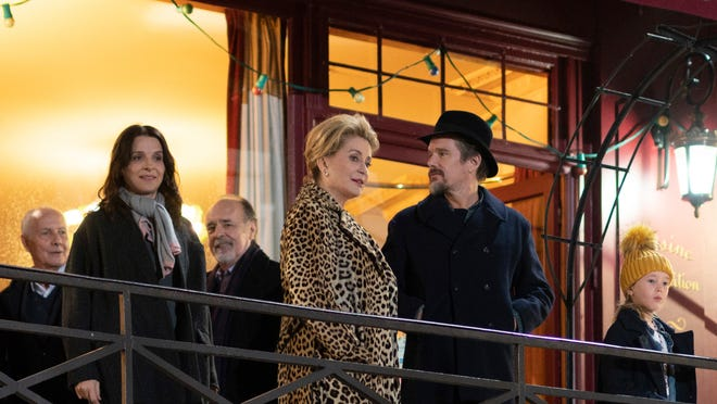 "This image released by IFC Films shows, foreground from left, Juliette Binoche, Catherine Deneuve, Ethan Hawke and Clémentine Grenier in a scene from ""The Truth."""