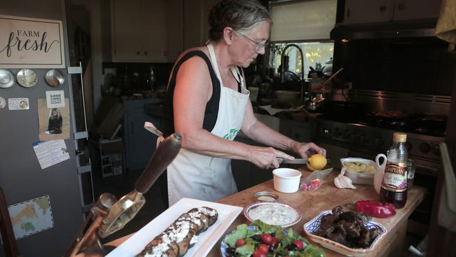 Janet Little cooks food inspired by the Mediterranean region for the Quincy Farmers Market live cooking show, which is filmed in her home in Quincy on Wednesday August 12, 2020.