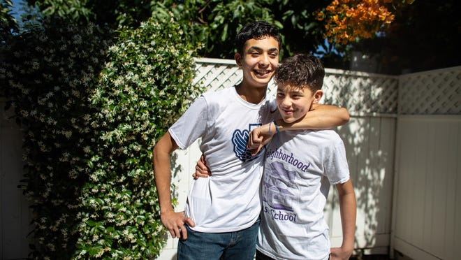 Sebastian Hernandez, left, 15 and his brother Benjamin, 12, pose for a portrait during the coronavirus pandemic on Sunday, May 24, 2020 in Los Angeles. While some kids are stressed, confused, bored and isolated during quarantine, the Hernandez brothers have relished the opportunity to slow down.
