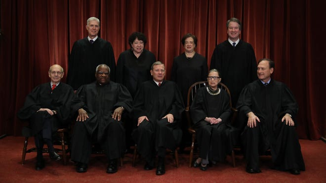 The United States Supreme Court, from front left, Associate Justice Stephen Breyer, Associate Justice Clarence Thomas, Chief Justice John Roberts, Associate Justice Ruth Bader Ginsburg, Associate Justice Samuel Alito, Jr.; from back left, Associate Justice Neil Gorsuch, Associate Justice Sonia Sotomayor, Associate Justice Elena Kagan and Associate Justice Brett Kavanaugh pose for their official portrait at the in the East Conference Room at the Supreme Court building Nov. 30, 2018 in Washington, D.C.