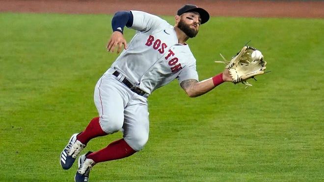 Boston Red Sox right fielder Kevin Pillar makes a sliding catch on a ball hit by Baltimore Orioles' Hanser Alberto during the second inning of a baseball game, Thursday, Aug. 20, 2020, in Baltimore.