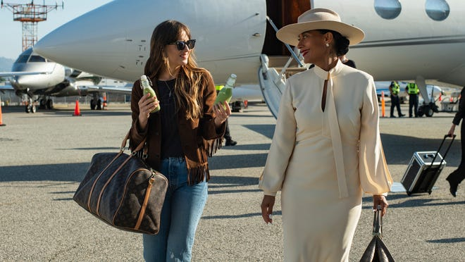 "Dakota Johnson, left, and Tracee Ellis Ross in a scene from ""The High Note."""