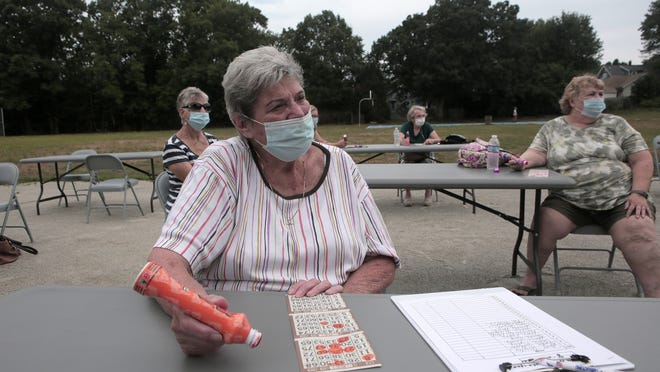 Janet Crowley, from Braintree, plays bingo with her friends during the outside senior bingo gathering at Penniman Park in Braintree on Tuesday August 25, 2020. Photo by Lauren Owens Lambert / for The Patriot Ledger.