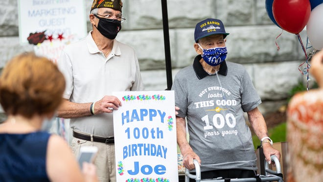 Vincent Albanese (left) stands next to his brother, Joseph Albanese, a WWII veteran celebrating his 100th birthday, at Brightview Assisted Living Center in Arlington, Sept. 10, 2020.