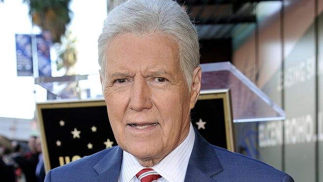 """FILE - Alex Trebek, host of """"Jeopardy!"""" attends a ceremony honoring the show's executive producer Harry Friedman with a star on the Hollywood Walk of Fame in Los Angeles, in this Friday, Nov. 1, 2019, file photo. """"Jeopardy!"""" host Alex Trebek died Sunday , Nov. 8, 2020, after battling pancreatic cancer for nearly two years. Trebek died at home with family and friends surrounding him, """"Jeopardy!"""" studio Sony said in a statement. Trebek presided over the beloved quiz show for more than 30 years."""