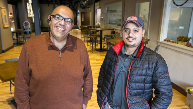 Mustafa Abdall, left, and Moses Allen took over ownership of Ronit's Kitchen on Wednesday and renamed it Guzel. It is located inside Rockford Indoor City Market, 116 N. Madison St., Rockford.
