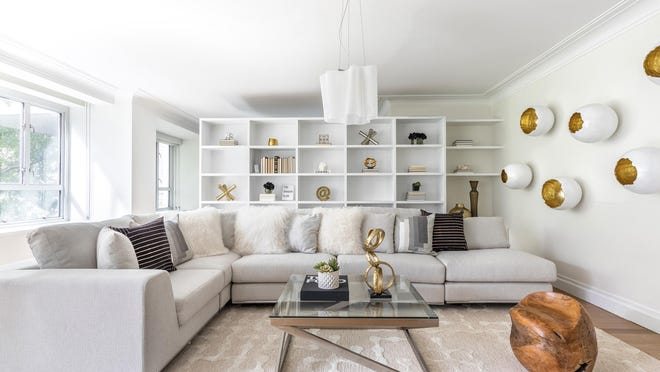 A sectional sofa helps frame a space in this living room.