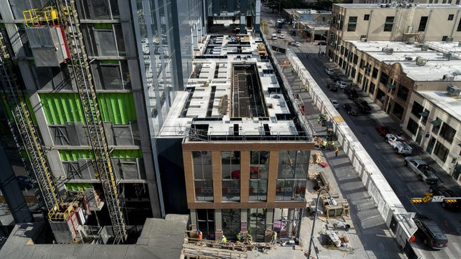 Construction continues on the 5th and Brazos development in downtown Austin on Thursday. The project will include more than 400 hotel rooms. The Austin City Council is considering adding a 1% to 2% assessment on hotels that have more than 100 rooms.