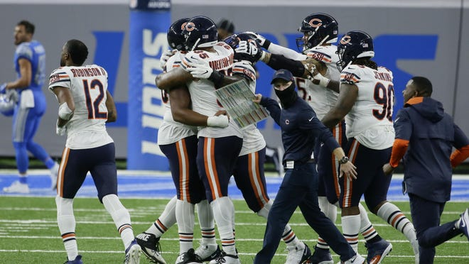 Chicago Bears players celebrate after beating the Detroit Lions 27-23 after an NFL football game in Detroit, Sunday, Sept. 13, 2020.