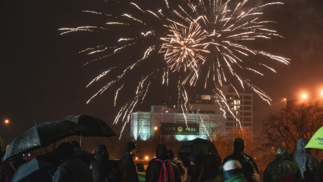 A crowd watches fireworks over Davis Park at last year's Stroll On State in downtown Rockford. This year the holiday event's fireworks will be set off at multiple locations throughout the city on Nov. 28.