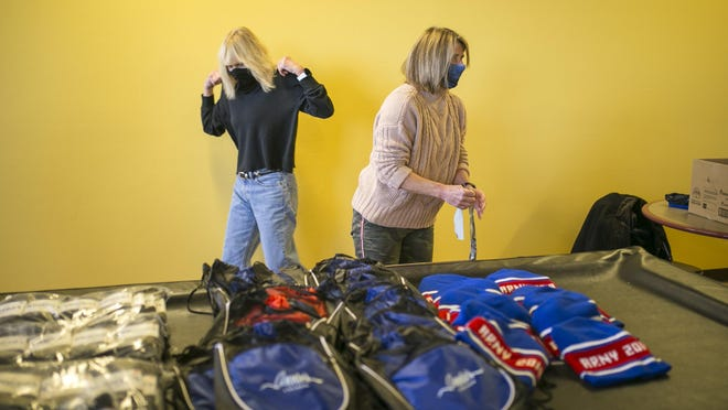 Volunteer Julie Beck of Annie's Locker, left, and Terri O'Dell, president of Annie's Locker, prepare to distribute winter hats and socks on Friday to members of the Jubilee Center in Rockford. Jubilee,  413 N. Court St., is a drop-in center that supports individuals with a diagnosis of mental illness or who are experiencing homelessness. Annie's locker is a nonprofit organization whose mission includes helping people in the Stateline area to lead healthier lives.