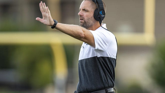 Vandegrift head coach Drew Sanders led the Vipers to a 38-6 win over Hutto Friday.