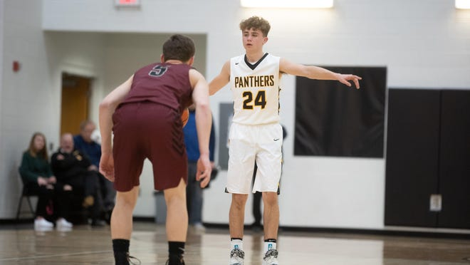 Lena-Winslow's Alex Daughenbaugh dribbles in front of Dakota's Silas Rieman on Jan. 6, 2019, at Lena-Winslow High School in Lena. Le-Win's school board voted Friday to go ahead with the 2020-2021 basketball season.