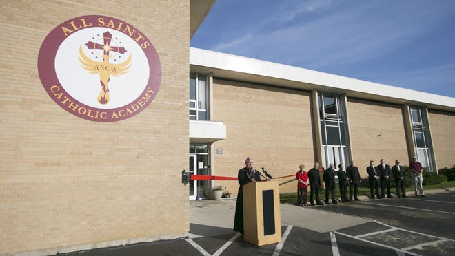 Bishop David Malloy speaks during the grand opening ceremony Aug. 28, 2019, at All Saints Catholic Academy in Rockford.