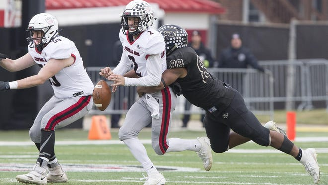 Lena-Winslow's Isaiah Bruce, shown causing a fumble by Central A&M's All-State quarterback Connor Heaton in the 2019 Class 1A state championships, is an Iowa recruit and has been picked as the 12th greatest football player in Freeport-area history.