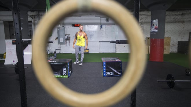 William Beal, co-owner and coach, leads a CrossFit session at Pretzel City CrossFit on Friday in Freeport.