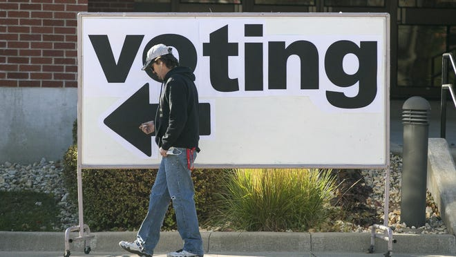 A voter walks to his polling location at Our Savior's Lutheran Church on Tuesday in Rockford.