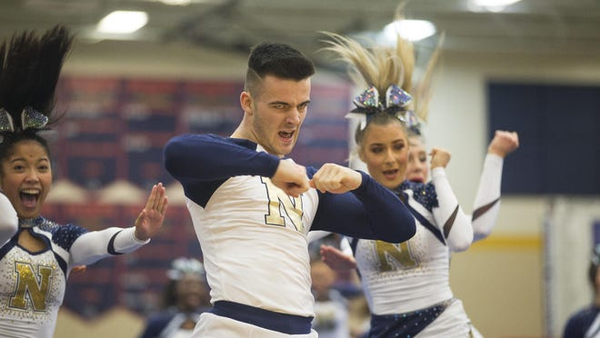 Belvidere North High School performs on the floor in the coed team category of the 2020 IHSA Cheer Sectional on Feb. 1, 2020, on Belvidere North High School in Belvidere. Belvidere eventually finished as the state runnerup.