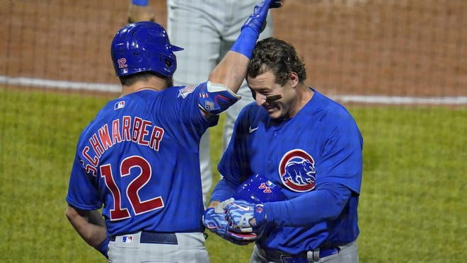Chicago Cubs' Anthony Rizzo, right, celebrates with Kyle Schwarber (12) as he returns to the dugout after hitting a two run home run on Tuesday in Pittsburgh, Tuesday.
