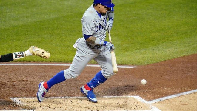 Chicago Cubs' Javier Baez drives in a run from third with a bunt single off Pittsburgh Pirates starting pitcher JT Brubaker on Monday.