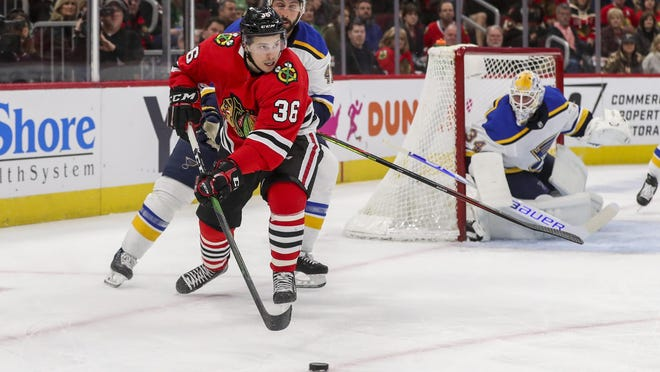 Chicago Blackhawks center Matthew Highmore (36) passes the puck during the first period against the St. Louis Blues on Sunday, March 8, 2020 at the United Center in Chicago.