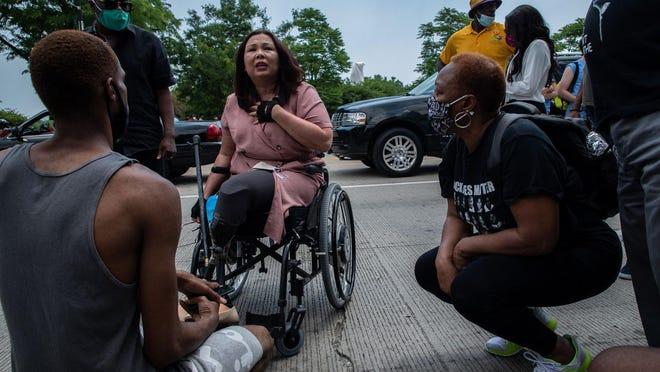 U.S. Sen. Tammy Duckworth talks with marchers before a Juneteenth march on on Columbus Drive in Grant Park on June 19, 2020.