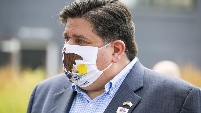 Gov. JB Pritzker meets with attendees at City Market on Thursday, July 16, 2020, in Rockford, after his visit to promote the 2020 Census.