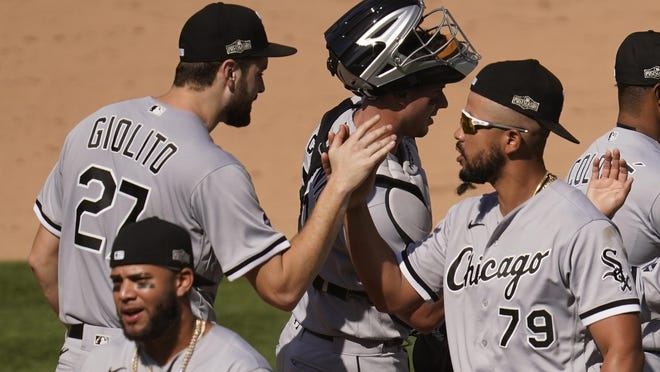 Chicago White Sox pitcher Lucas Giolito (27) celebrates with Jose Abreu (79) after the White Sox defeated the Oakland Athletics in Game 1 of an American League wild-card series Tuesday in Oakland, Calif.