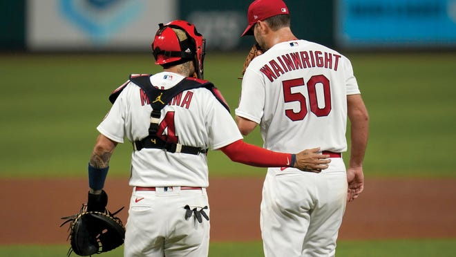 Yadier Molina talks with starting pitcher Adam Wainwright during a game this season at Busch Stadium in St. Louis.