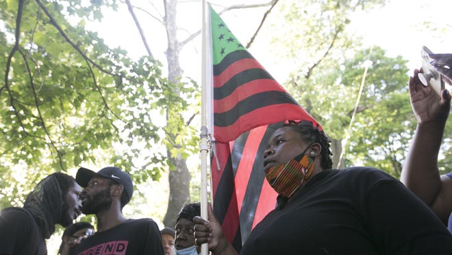 Ashley D. Williams of Rockford addresses the crowd at Haskell Park on Tuesday, June 2, 2020, in Rockford, after a march through downtown to speak out against police brutality.