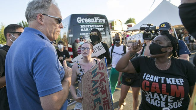Protesters confront state Sen. Dave Syverson on Friday, June 5, 2020, at Greenfire restaurant in Rockford. Rockford Youth Activism led its fourth protest against police brutality and racism, stopping at various locations near Riverside Boulevard and Perryville Road.