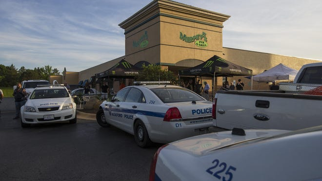 Protesters encountered a line of police officers and police vehicles on Saturday, June 6, 2020, outside Murphy's Pub and Grill, 510 S. Perryville Road in Rockford. Marchers protested police brutality and racism in front of the business but were not allowed inside.