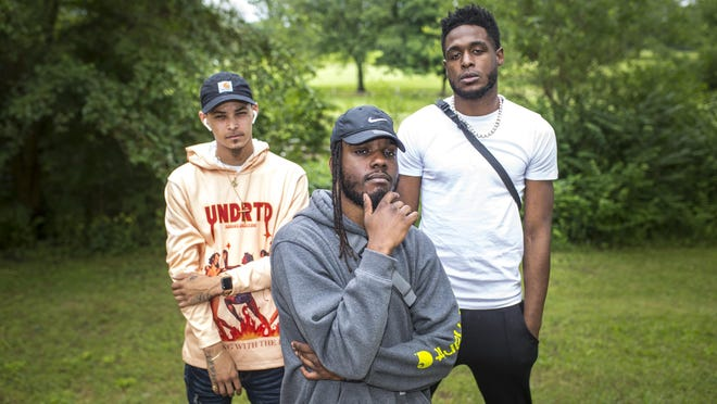 """The musical artists, from left, Swift, ERT, and Billi Hendrixxx, pose for a portrait at the city's north side on Friday, June 26, 2020, in Rockford. Tre Williams, the artist known as ERT, released his new single, """"Mental,"""" on Friday."""