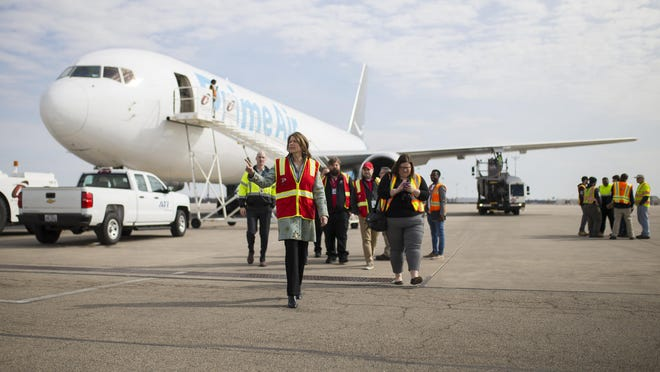 U.S. Rep. Cheri Bustos, center, tours an Amazon PrimeAir plane and meets airport workers on March 29, 2019, at Chicago Rockford International Airport in Rockford.