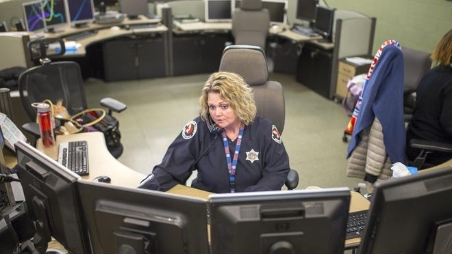 Officials are still working to restore 911 call lines at Rockford's 911 center as some telecommunicators are having trouble hearing callers. The city is answering calls out of the county 911 center until the issue is resolved. In this December 2018 file photo, Brenda Ganz works on the phone at Winnebago County 911 Center in Rockford.