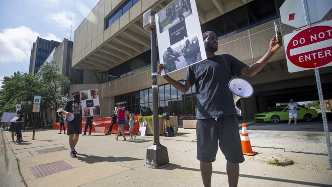 Leslie Rolfe, spokesman for Rockford Youth Activism, during Friday's demonstration at the Winnebago County Courthouse.