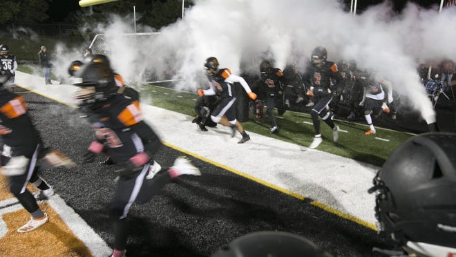 The Harlem football team enters the field before their game against Belvidere North on Oct. 11, 2019, in Machesney Park. The IHSA announced on Wednesday that if their most recent plan is approved, the high school football season will move to the spring.