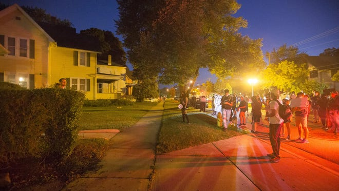 Protesters, right, confront Mayor Tom McNamara, left, at his home on Harlem Boulevard. Protesters mostly from the Justice for May 30 group marched to McNamara's home at the 1000 block of Harlem Boulevard on Saturday in Rockford, to advocate for charges against protesters arrested on May 30 to be dropped.