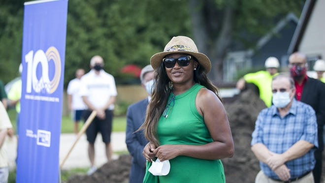 Gina Meeks, the Strong Neighborhood House coordinator, makes opening remarks Thursday at a groundbreaking ceremony for the future Marie Avenue Strong Neighborhood House in Machesney Park.