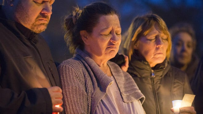 Jonathan and Carol Feldberg of Rockford, from left, and Carol's aunt, Susan Swanson, stand with each other at a candlelight vigil on Feb. 27, 2018, at 10th Avenue Park in Rockford.The Feldbergs' daughter Danielle Son and her boyfriend, Sergio Quiroz, were shot to death.