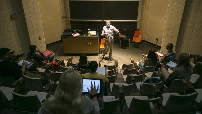 Before he started teaching his freshman seminar course at Rockford University on Wednesday, professor Timothy Adams instructed students to be sure to sit at least two seats apart from each other in every other row.