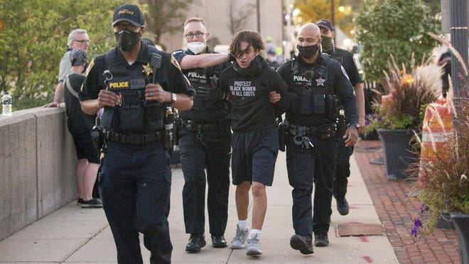 Four people were arrested during protests at City Market and outside of CJs Public House on Friday in Rockford.