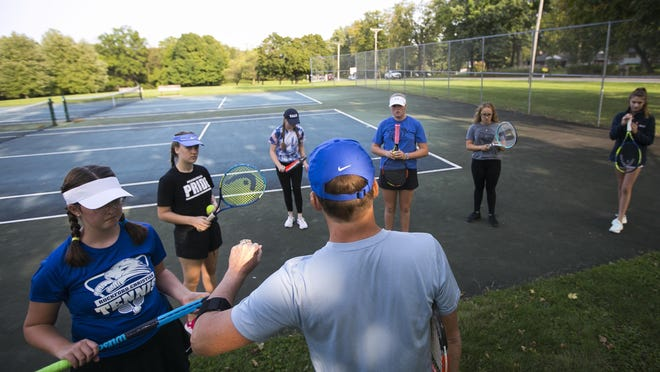 Co-head coach Rob Buelte leads the Rockford Christian girls tennis team during one of their first meetings of the team's history at Guilford Center Park on Thursday in Rockford. Senior Savannah Jackson was instrumental in starting the team.