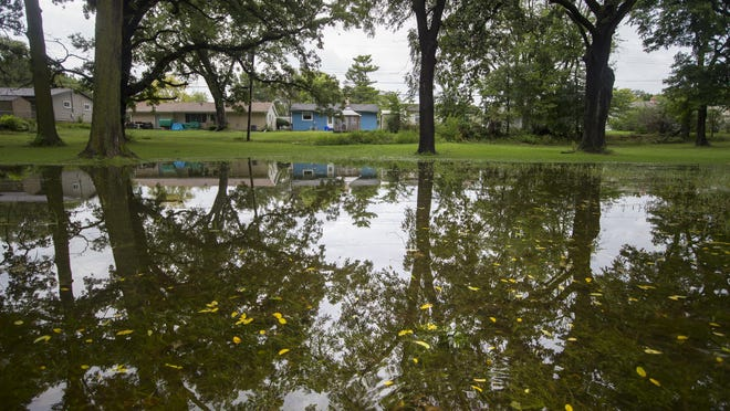 A large puddle forms in the grass at Blackhawk Park on Saturday in Rockford. Rockford has been soaked by nearly 6 inches of rain since Tuesday, according to meteorologist Brian Leatherwood of the National Weather Service Office in Romeoville.